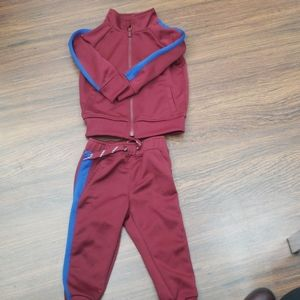 Maroon and royal blue track suit